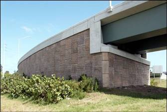 a reinforced earth wall supporting an on/off ramp