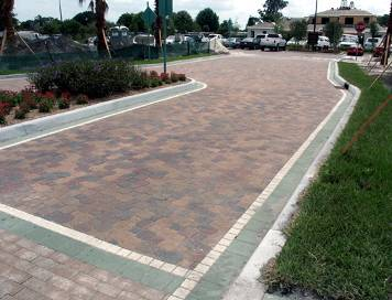 a walkway paved with different sizes and colors of bricks