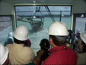 workers in the control room of the massive dragline