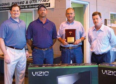 Steve Beals, right, presents a plaque honoring Sharpe Bros.' safety record to Vecellio Group V.P. Michael Vecellio, left, Sharpe Bros. Field Safety Manager John Riley, Jr., and Sharpe V.P. Ivan Clayton.  (Photo by Gloria Fields)
