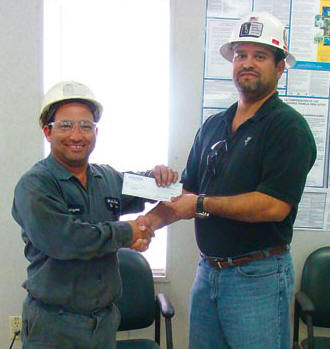 "Rolayme Fabelo, left, is White Rock Quarries' 2012 Safety Phrase contest winner with ""Chance Takers Are Accident Makers."" At right is WRQ Safety Director Tony Diaz. (Photo by JR Payne)"
