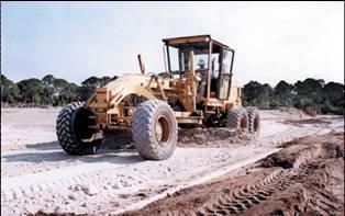 a grader leveling gravel