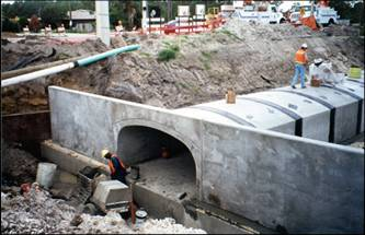 workers installing a pre-cast concrete culvert